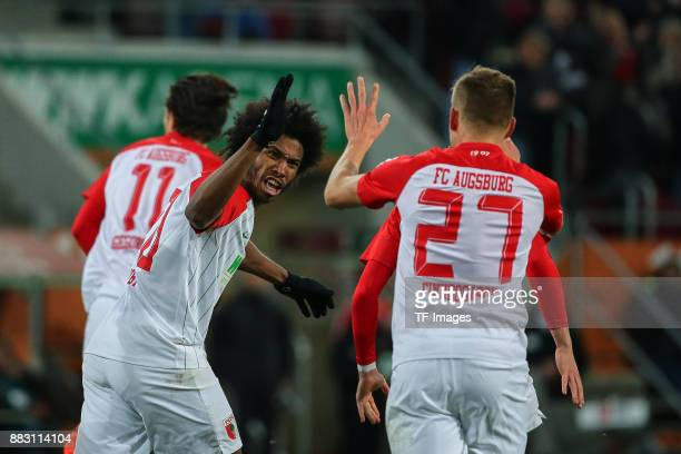 Francisco da Silva Caiuby of Augsburg and Alfred Finnbogason of Augsburg celebrate their team`s first goal during the Bundesliga match between FC...