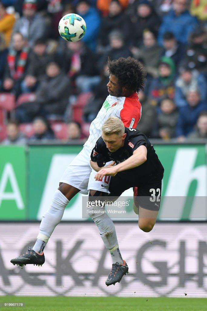 Francisco da Silva Caiuby of Augsburg and Andreas Beck of Stuttgart jump for a header during the Bundesliga match between FC Augsburg and VfB Stuttgart at WWK-Arena on February 18, 2018 in Augsburg, Germany.
