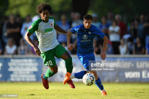 Francisco da Silva Caiuby of Augsburg and Christos Nikiforidis of Olching compete for the ball during the preseason friendly match between SC Olching...