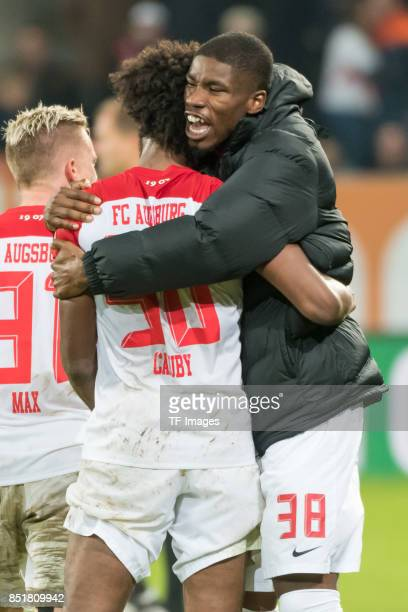 Francisco da Silva Caiuby of Augsburg and Kevin Danso of Augsburg looks on during the Bundesliga match between FC Augsburg and RB Leipzig at WWKArena...