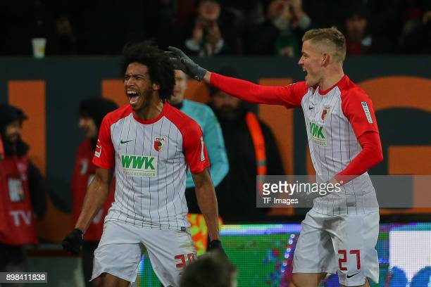 Francisco da Silva Caiuby of Augsburg celebrates after scoring his team`s first goal with Alfred Finnbogason of Augsburg during the Bundesliga match...