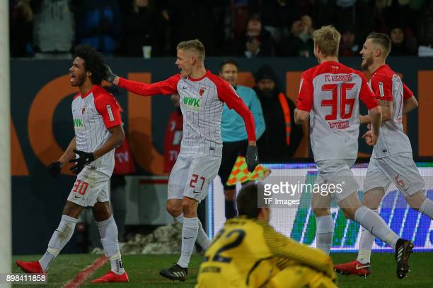 Francisco da Silva Caiuby of Augsburg celebrates after scoring his team`s first goal with Alfred Finnbogason of Augsburg Martin Hinteregger of...