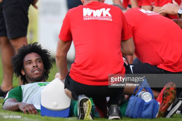 Francisco da Silva Caiuby of Augsburg is being treated on the sideline during the preseason friendly match between SC Olching and FC Augsburg on July...