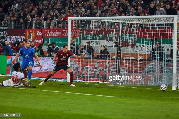Francisco da Silva Caiuby of FC Augsburg goalkeeper Christian Mathenia of 1 FC Nuernberg and Georg Margreitter of 1 FC Nuernberg in action during the...