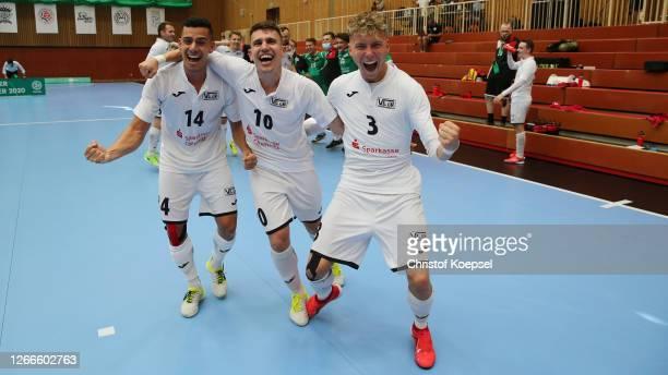 Francisco de Olivei, Valente Fogaca and Daniel Klima of SV Hohenstein-Ernstthal celebrate after wimning the German Futsal Championship Final match...