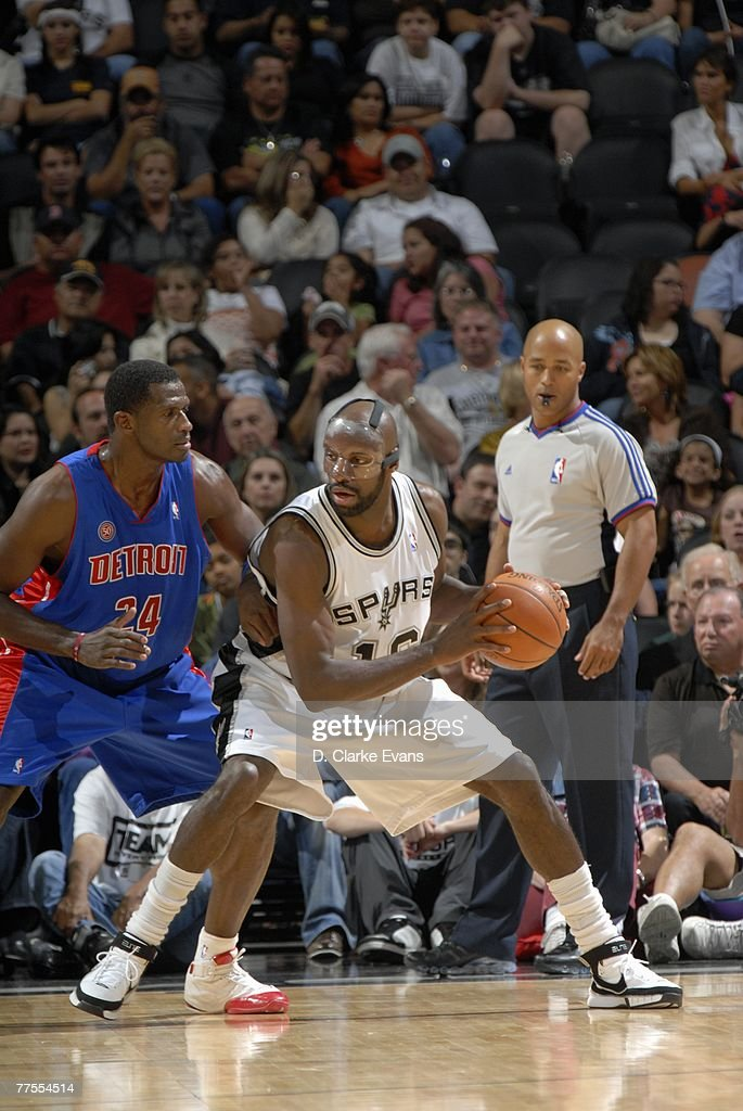 Francisco Elson #16 of the San Antonio Spurs post up against Antonio McDyess #24 of the Detroit Pistons during a preseason game at AT&T Center on October 20, 2007 in San Antonio, Texas. The Spurs won 104-80.