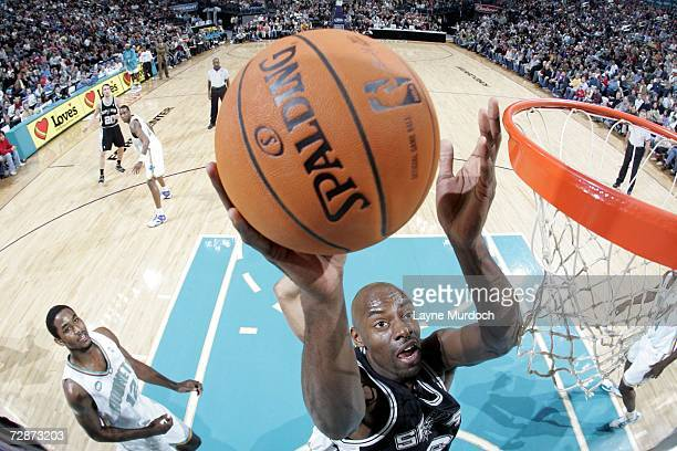 Francisco Elson of the San Antonio Spurs shoots the ball against the New Orleans/Oklahoma City Hornets during an NBA game at the Ford Center December...
