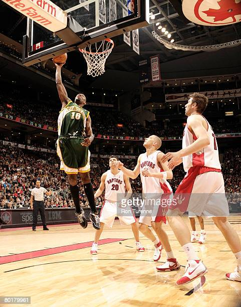 Francisco Elson of the Seattle SuperSonics puts up the shot against Carlos Delfino Anthony Parker and Andrea Bargnani of the Toronto Raptors on March...