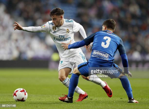 Francisco Feuillassier of Real Madrid competes for the ball with Fran Garcia of Fuenlabrada during the Copa del Rey round of 32 second leg match...