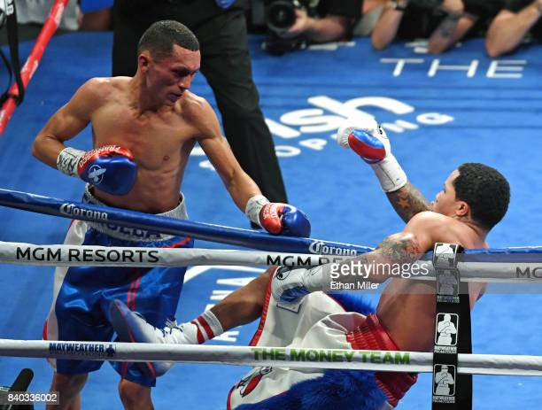 Francisco Fonseca looks on as Gervonta Davis falls into the ropes in the seventh round of their junior lightweight bout at T-Mobile Arena on August...