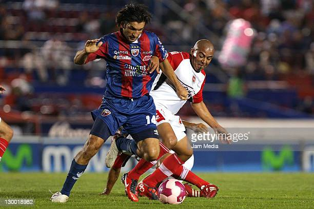 Francisco Fonseca of Atlante struggles for the ball with Edigio Arevalo of Tijuana during a match as part of the Apertura 2011 at Andres Quintana Roo...