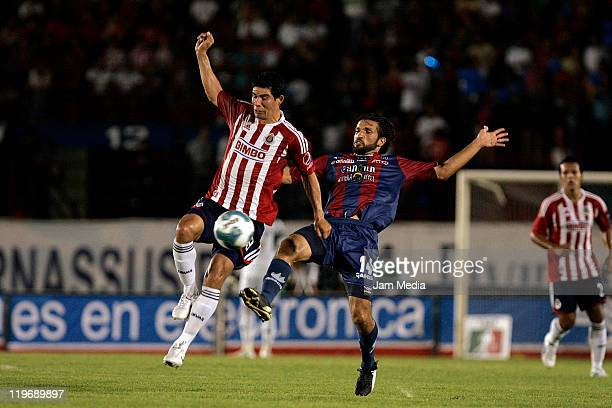 Francisco Fonseca of Atlante struggles for the ball with Jonny Magallon of Chivas during a match as part of the Apertura 2011 at Andres Quintana Roo...