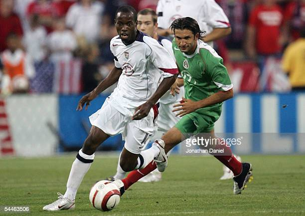 Francisco Fonseca of Mexico chases as DaMarcus Beasley of the USA moves the ball up field during the World Cup Qualifying match at Crew Stadium on...