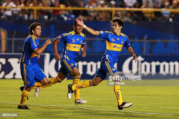 Francisco Fonseca of Tigres celebrates with teammates JOse Alfredo Tahuila and Jesus Molina a scored goal against San Luis during a match as part of...