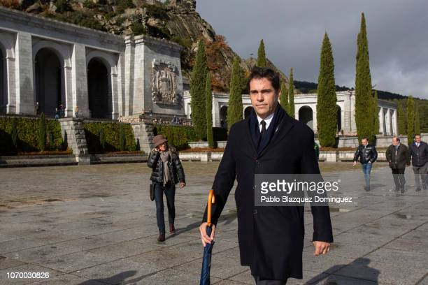 Francisco Franco's greatgrandson Luis Alfonso de Borbon leaves after a mass at the 'Valle de los Caidos' while a Spanish coat of arms from Franco's...