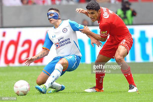 Francisco Gamboa of Toluca vies for the ball with Christian Gimenez of Cruz Azul during their Mexican Clausura 2016 football tournament match at...