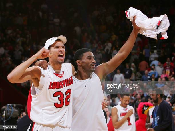 Francisco Garcia and Taquan Dean of the Louisville Cardinals celebrate after the Cardinals' victory over the West Virginia Mountaineers in overtime...