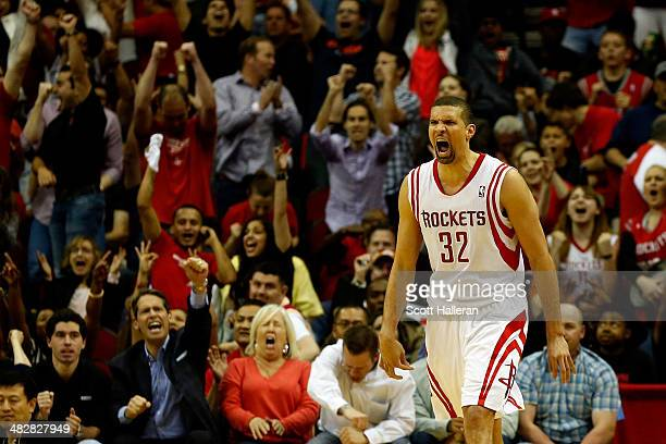 Francisco Garcia of the Houston Rockets celebrates after scoring a three pointer in the fourth period against the Oklahoma City Thunder during a game...