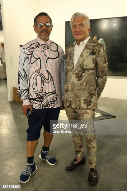 Francisco George wears Jeremy Scott and William Escalera of LACMA Museum wears a Gucci suit during Art Basel Miami Beach at Miami Beach Convention...