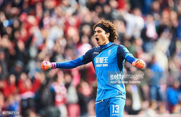 Francisco Guillermo Ochoa of Granada CF celebrates after his team mate David Rodriguez Lomban of Granada CF scored during the La Liga match between...