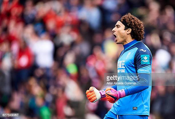 Francisco Guillermo Ochoa of Granada CF celebrates after scoring Andreas Pereira of Granada CF during the La Liga match between Granada CF and...