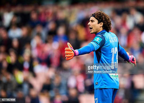 Francisco Guillermo Ochoa of Granada CF reacts on during the La Liga match between Granada CF and Sevilla FC at Estadio Nuevos Los Carmenes on...