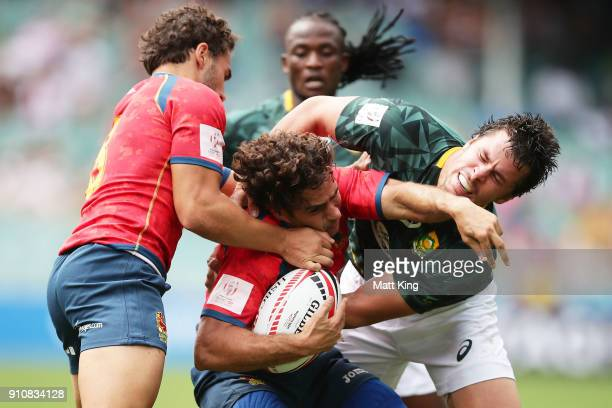 Francisco Hernandez of Spain is tackled by Ruhan Nel of South Africa during day two of the 2018 Sydney Sevens at Allianz Stadium on January 27 2018...