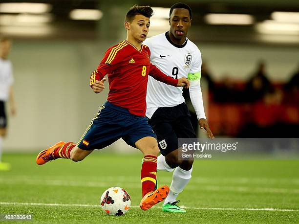 Francisco J Villalba of Spain passes under pressure from Kaylen Hinds of England during a U16 International match between England and Spain at St...