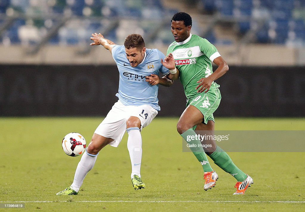 Francisco Javi Garcia of Manchester City holds off Sthembiso Ncgobo of AmaZulu during the Nelson Mandela Football Invitational match between AmaZulu and Manchester City at Moses Mabhida Stadium on July 18, 2013 in Durban, South Africa.