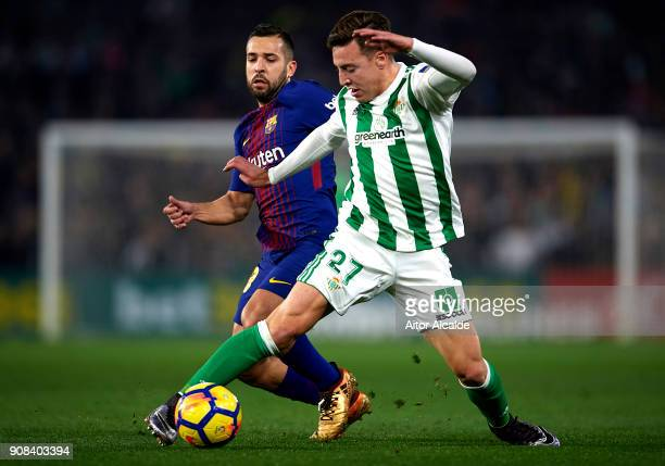 Francisco Javier Guerrero Francis of Real Betis Balompie being followed by Jordi Alba of FC Barcelona during the La Liga match between Real Betis and...