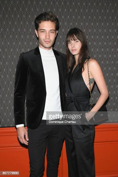 Francisco Lachowsk and a guesti attend the Miu Miu aftershow party as part of the Paris Fashion Week Womenswear Spring/Summer 2018 at Boum Boum on...