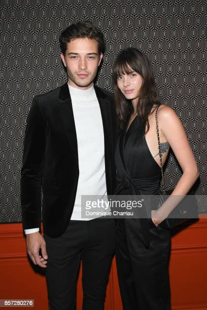 Francisco Lachowski and guest attend the Miu Miu aftershow party as part of the Paris Fashion Week Womenswear Spring/Summer 2018 at Boum Boum on...