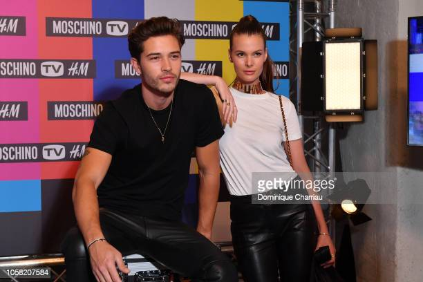 Francisco Lachowski and Jessiann Gravel arrives at MOSCHINO [tv] HM Launch Party at Le Dernier Etage on November 6 2018 in Paris France