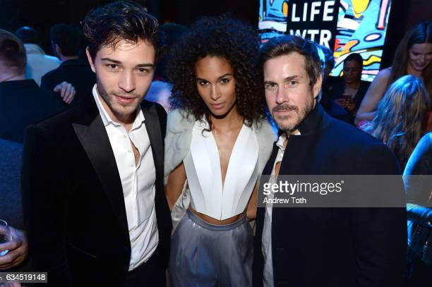 Francisco Lachowski Cindy Bruna and Mark Tevis attend The Daily Front Row x LIFEWTR New York Fashion Week opening night at Kola House on February 9...
