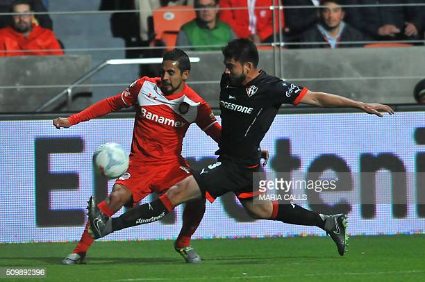 Francisco Leon of Atlas vies for the ball with Oscar Rojas of Toluca during the Mexican Clausura 2016 Tournament at the Nemesio Diez stadium on...