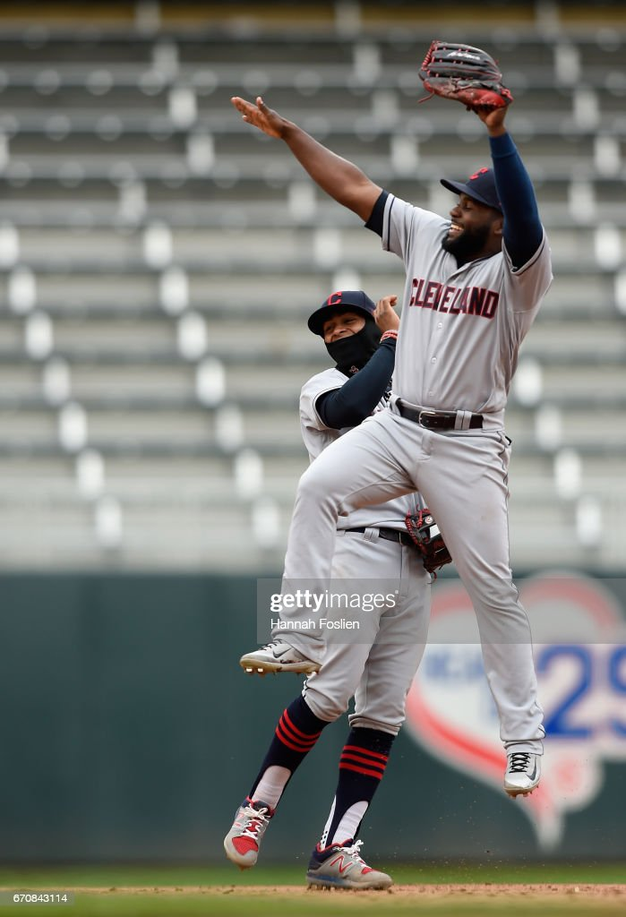 Francisco Lindor #12 and Abraham Almonte #35 of the Cleveland Indians celebrate winning the game against the Minnesota Twins on April 20, 2017 at Target Field in Minneapolis, Minnesota. The Indians defeated the Twins 6-2.