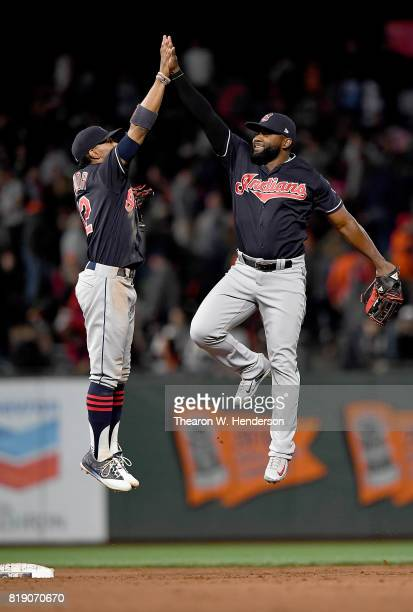 Francisco Lindor and Abraham Almonte of the Cleveland Indians celebrates defeating the San Francisco Giants 53 at ATT Park on July 17 2017 in San...