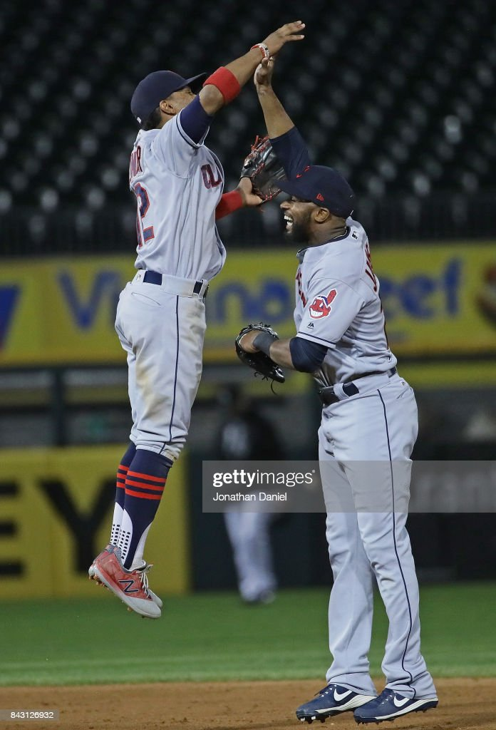 Francisco Lindor #12 (L) and Austin Jackson #26 of the Cleveland Indians celebrate a win over the Chicago White Sox at Guaranteed Rate Field on September 5, 2017 in Chicago, Illinois. The Indians defeated the White Sox 9-4.