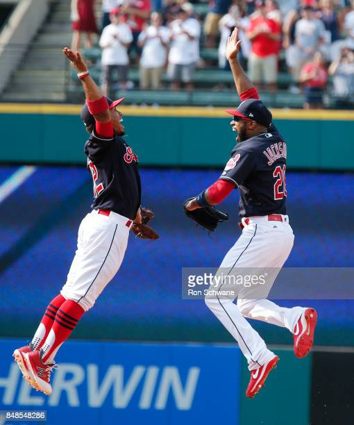 Francisco Lindor and Austin Jackson of the Cleveland Indians celebrate after beating the Kansas City Royals 32 at Progressive Field on September 17...