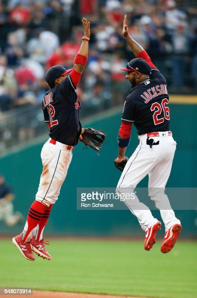 Francisco Lindor and Austin Jackson of the Cleveland Indians celebrate an 84 victory over the Kansas City Royals at Progressive Field on September 16...