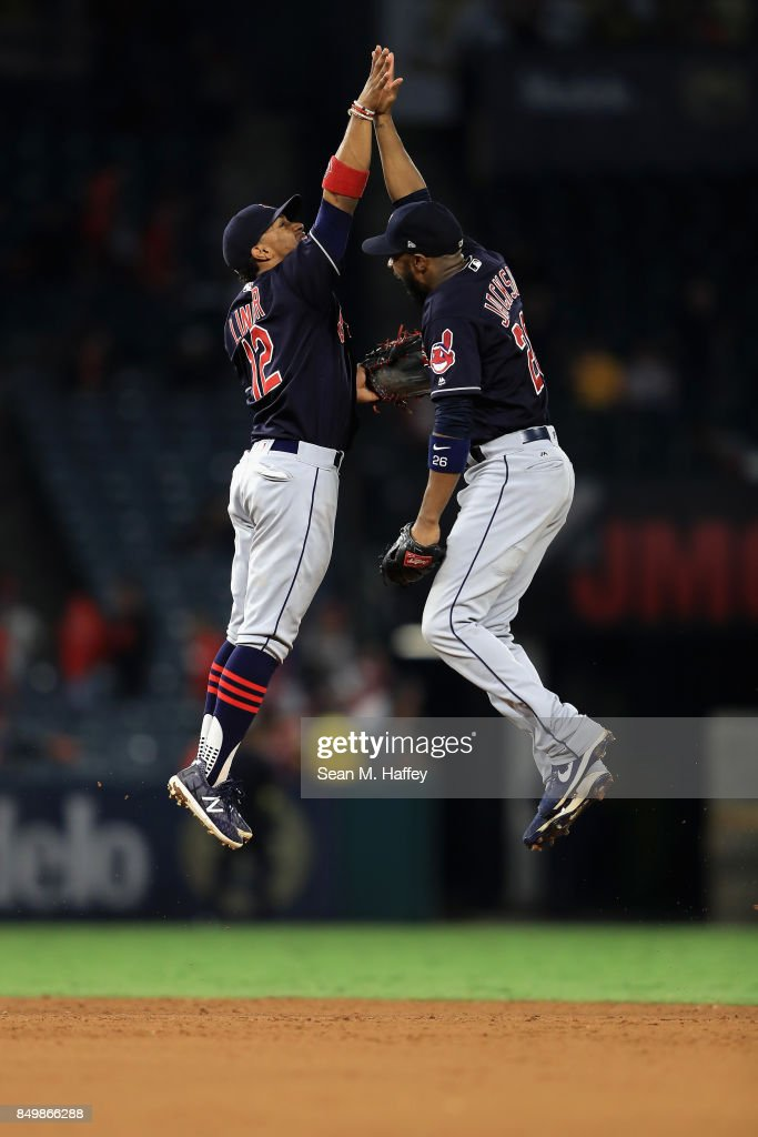 Francisco Lindor #12 and Austin Jackson #26 of the Cleveland Indians celebrate defeating the Los Angeles Angels of Anaheim 6-3 in a game at Angel Stadium of Anaheim on September 19, 2017 in Anaheim, California.