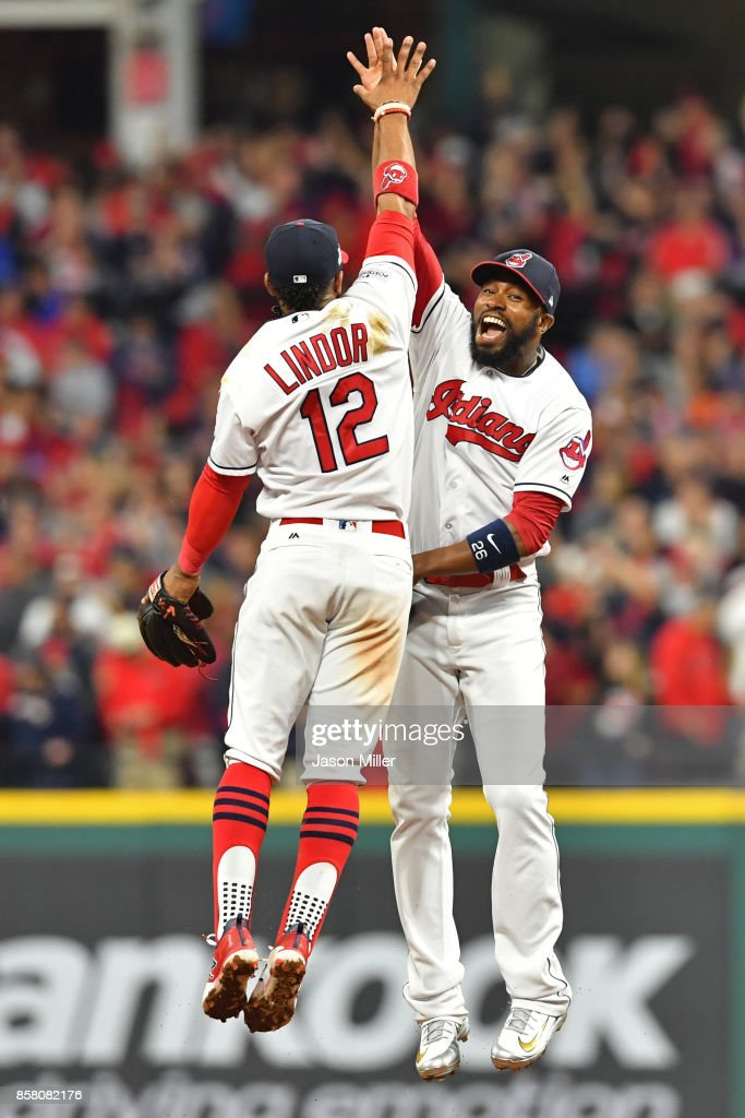 Francisco Lindor #12 and Austin Jackson #26 of the Cleveland Indians celebrate their teams victory over the New York Yankees in game one of the American League Division Series at Progressive Field on October 5, 2017 in Cleveland, Ohio. The Cleveland Indians defeated the New York Yankees 4-0.