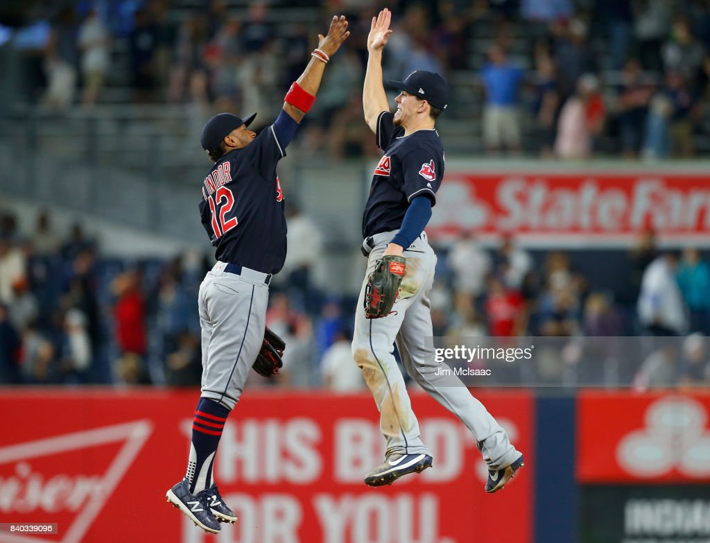 Francisco Lindor #12 and Bradley Zimmer #4 of the Cleveland Indians celebrate after defeating the New York Yankees at Yankee Stadium on August 28, 2017 in the Bronx borough of New York City.