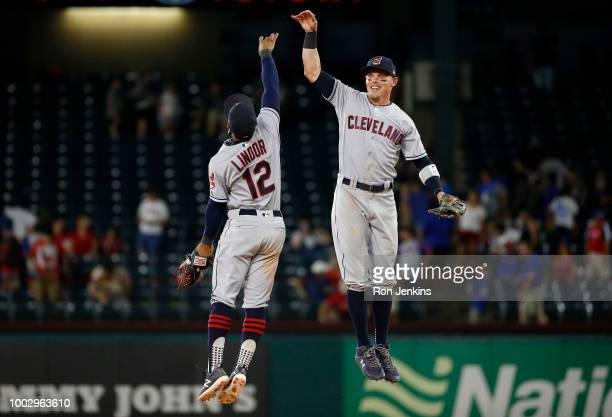 Francisco Lindor and Brandon Guyer of the Cleveland Indians celebrate the team's 98 eleventh inning win over the Texas Rangers at Globe Life Park in...