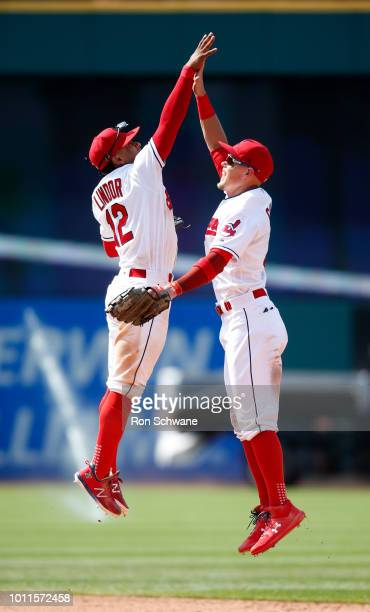 Francisco Lindor and Brandon Guyer of the Cleveland Indians celebrate a 43 victory over the Los Angeles Angels at Progressive Field on August 5 2018...