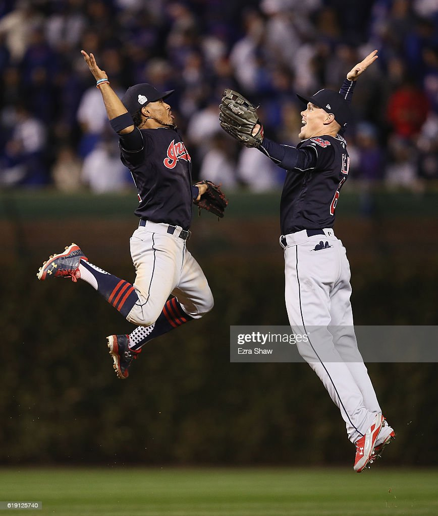 Francisco Lindor #12 and Brandon Guyer #6 of the Cleveland Indians celebrate after beating the Chicago Cubs 7-2 in Game Four of the 2016 World Series at Wrigley Field on October 29, 2016 in Chicago, Illinois.