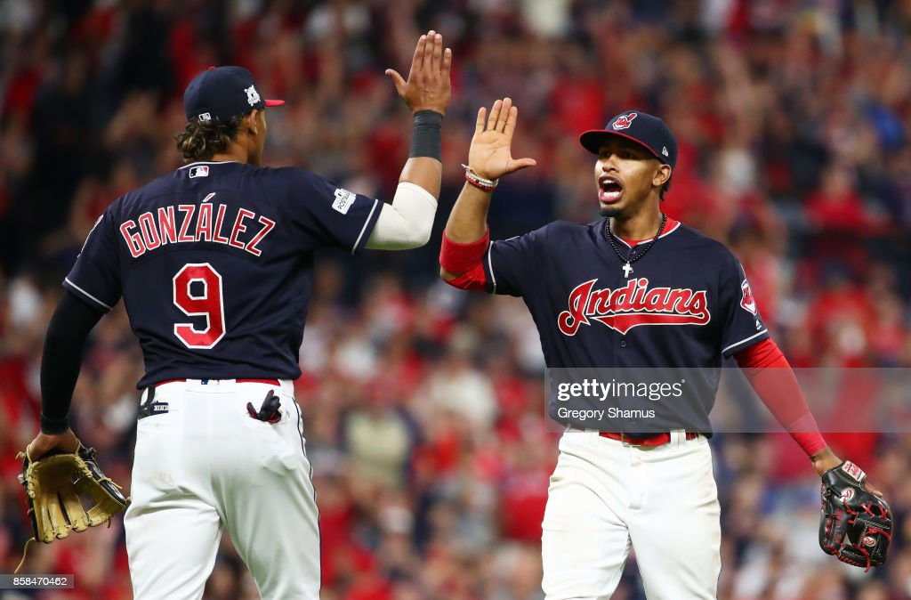 Francisco Lindor #12 and Erik Gonzalez #9 of the Cleveland Indians react after a call was overturned in the eleventh inning against the New York Yankees during game two of the American League Division Series at Progressive Field on October 6, 2017 in Cleveland, Ohio.