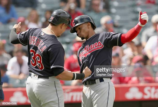 Francisco Lindor and Giovanny Urshela of the Cleveland Indians celebrate after both score on Lindor's three run home run in the fifth inning against...