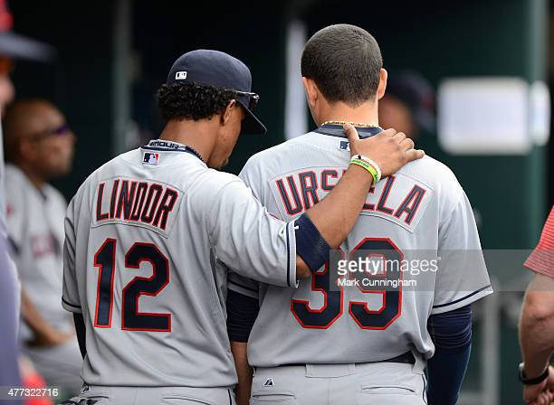 Francisco Lindor and Giovanny Urshela of the Cleveland Indians talk together in the dugout during the game against the Detroit Tigers at Comerica...