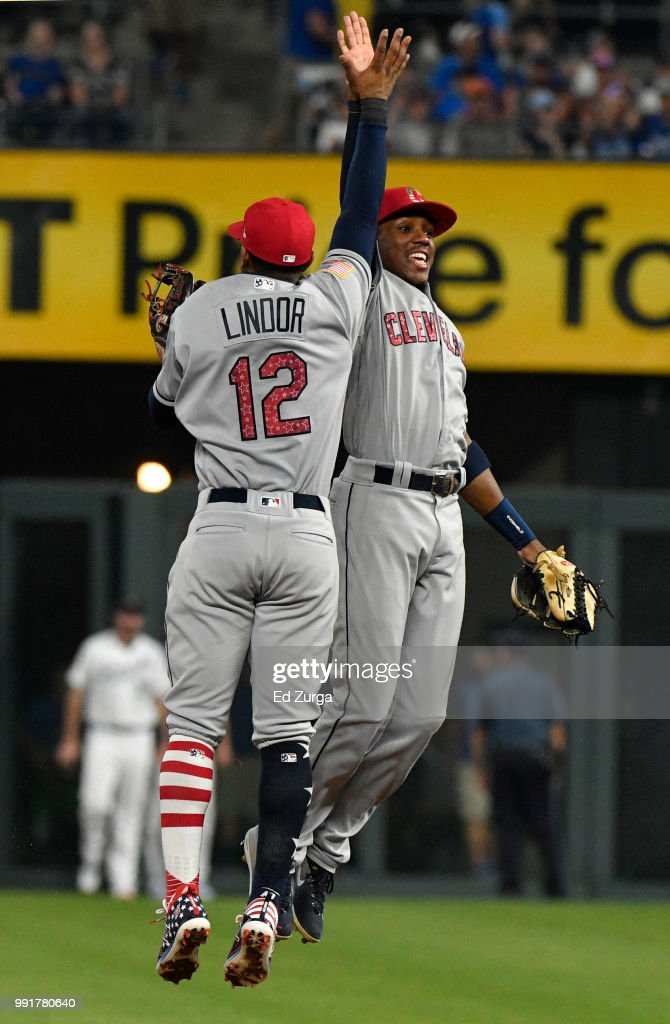Francisco Lindor #12 and Greg Allen #1 of the Cleveland Indians celebrate a 3-2 win over the Kansas City Royals at Kauffman Stadium on July 4, 2018 in Kansas City, Missouri.